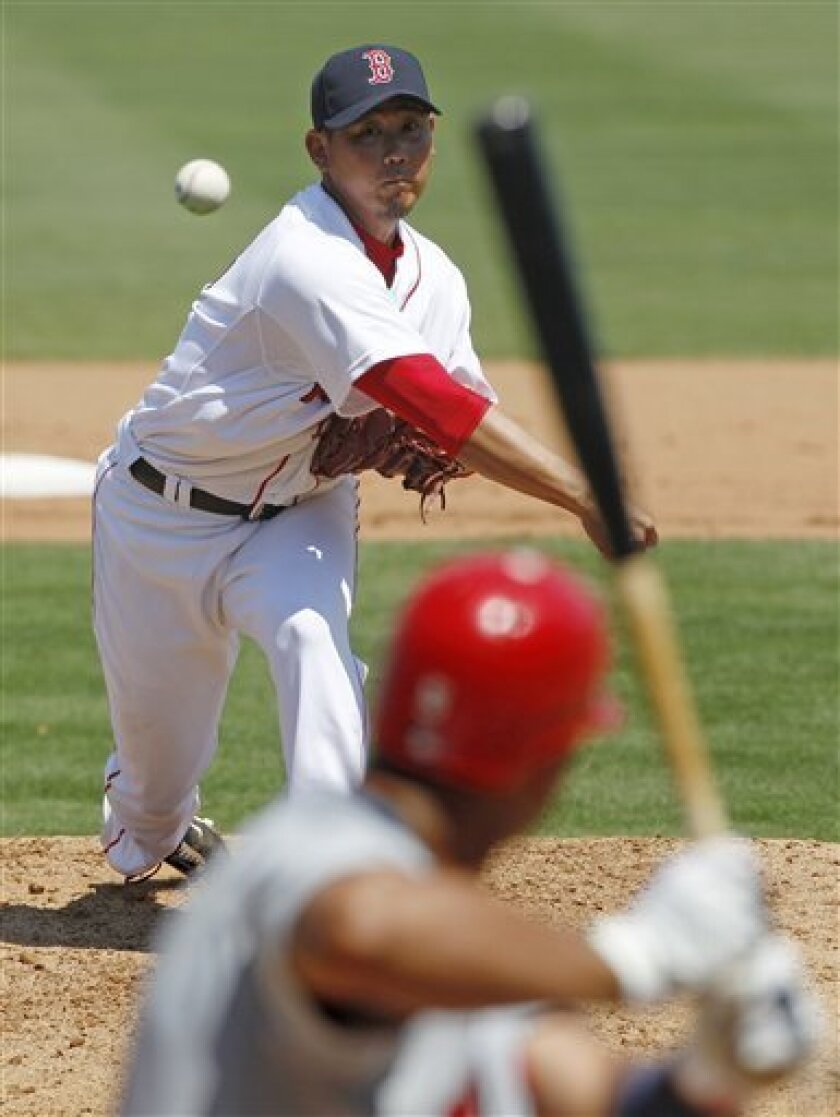 Boston Red Sox starter Daisuke Matsuzaka delivers to St. Louis Cardinals' Albert Pujols during the sixth inning of a spring training baseball game in Fort Myers, Fla., Sunday, March 20, 2011. Pujols walked on the at-bat. (AP Photo/Charles Krupa)