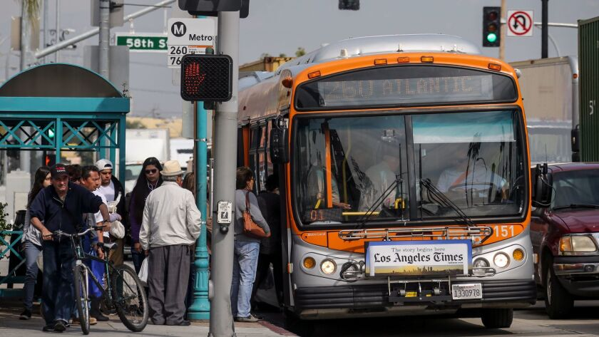 A busy bus stop at the intersection of Slauson Ave. and Atlantic Blvd. in Maywood.