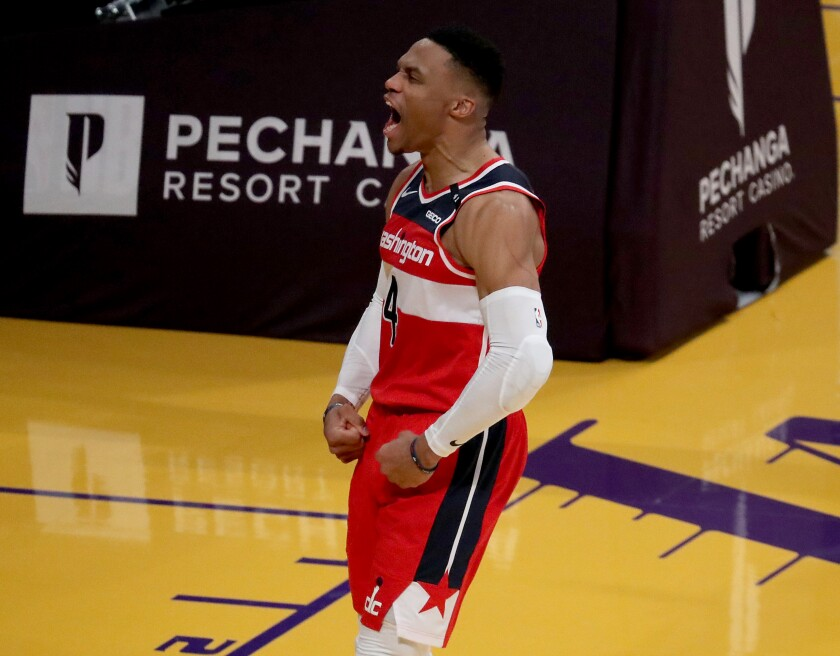 Wizards guard Russell Westbrook celebrates after scoring a basket against the Lakers.
