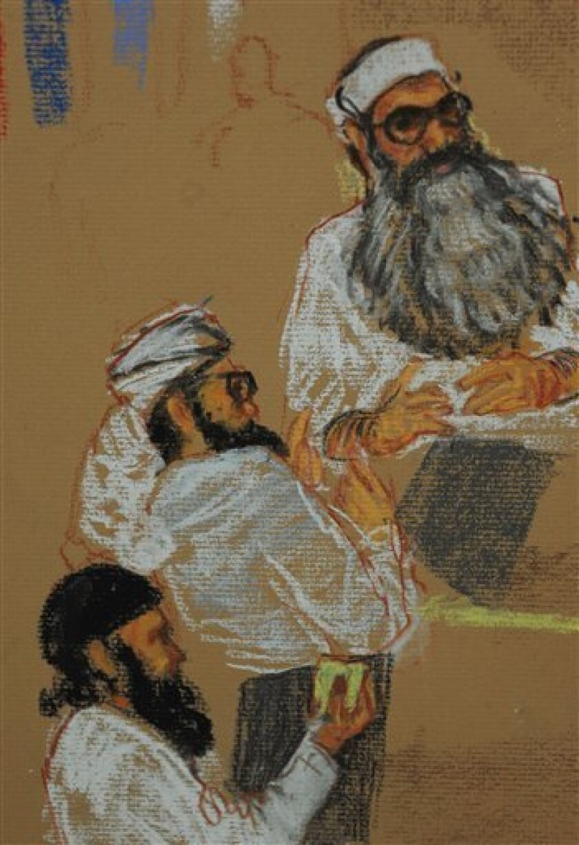 In a courtroom drawing reviewed by the US military, Khalid Sheikh Mohammed, top, Walid Bin Attash, center, and Ramzi Bin al Shibh attend a pre-trial hearing on charges related to the 9/11 attacks in Camp Justice on the U.S. Naval Base in Guantanamo Bay, Cuba, Monday, Dec. 8, 2008. Five men charged with plotting the Sept. 11 attacks told a military judge Monday that they want to immediately confess at their war-crimes tribunal at Guantanamo Bay, setting up likely guilty pleas and their possible executions. The two other defendants are not pictured in the sketch. (AP Photo/Janet Hamlin, Pool)