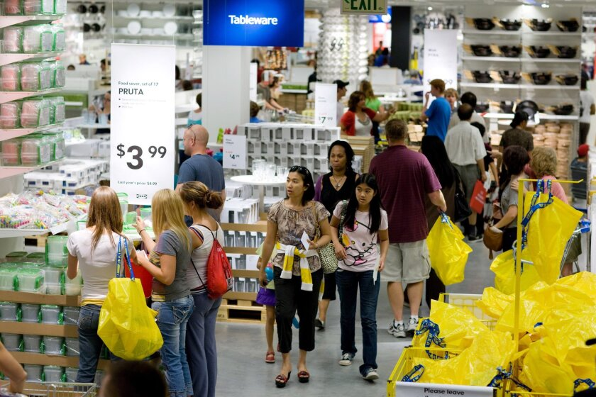 Customers shop inside the grand opening of this IKEA store in Centennial, Colorado, U.S., on Wednesday, July 27, 2011.