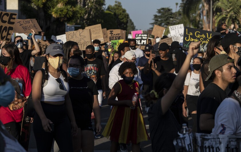 Protesters walk through a residential neighborhood in Hollywood on Wednesday.