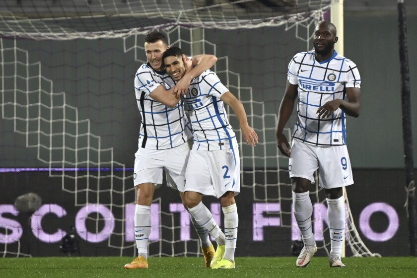 Inter Milan's Ivan Perisic, left, celebrates after scoring his side's second goal of the game during the Serie A soccer match between Fiorentina and Inter Milan, at the Artemio Franchi Stadium in Florence, Italy, Friday, Feb. 5, 2021. (Massimo Paolone/LaPresse via AP)