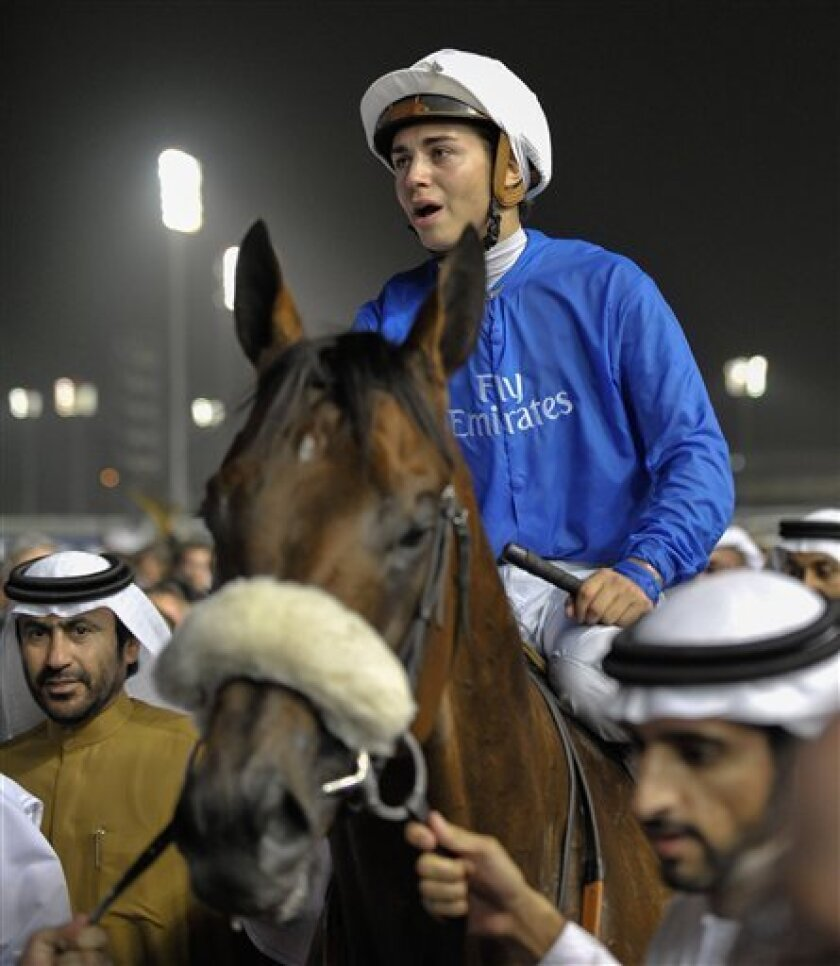 Mickael Barzalona on Monterosso from Great Britain after he won the Dubai World Cup race, Saturday, March 31, 2012, in Dubai, United Arab Emirates. (AP Photo/Stephen Hindley)