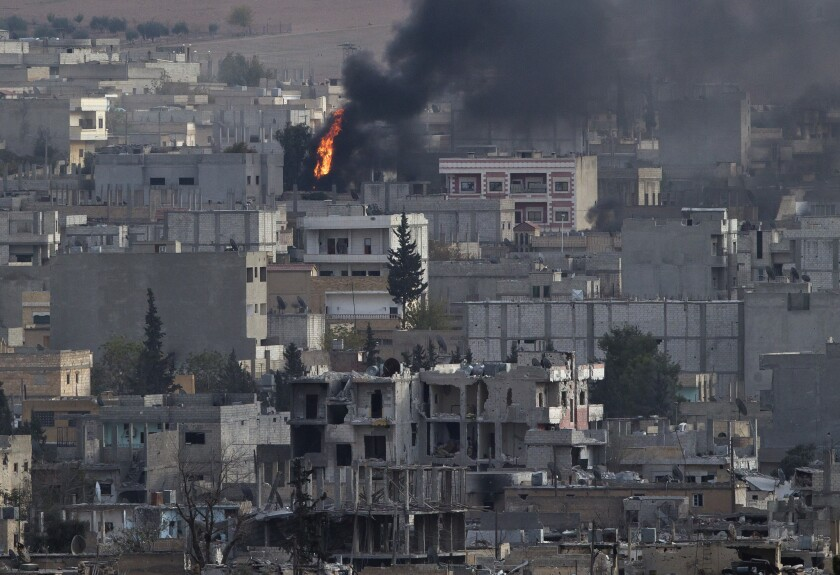 A fire in the Syrian city of Kobani is seen from a hilltop across the border in Turkey, on Nov. 13. Kobani has been under assault by Islamic State extremists since mid-September.