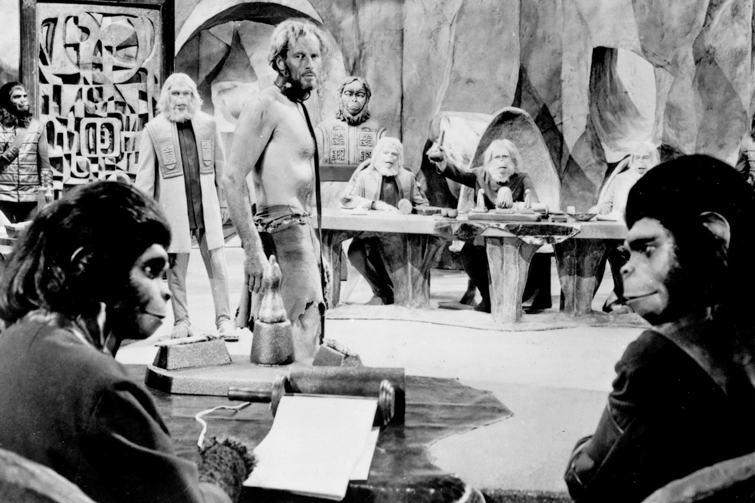 "Kim Hunter, left foreground, and Roddy McDowall, as chimpanzee scientists, with human Charlton Heston, center in the 1968's ""Planet of the Apes."""