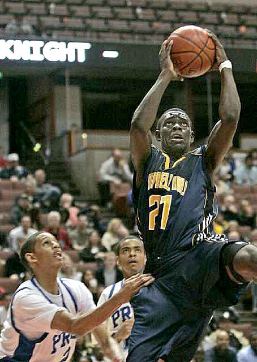 Campbell Hall's Jrue Holiday, driving for a basket against Price during the Southern Section Division III-AA final, is refreshingly unaffected by his status as an elite athlete who will play for UCLA next season.