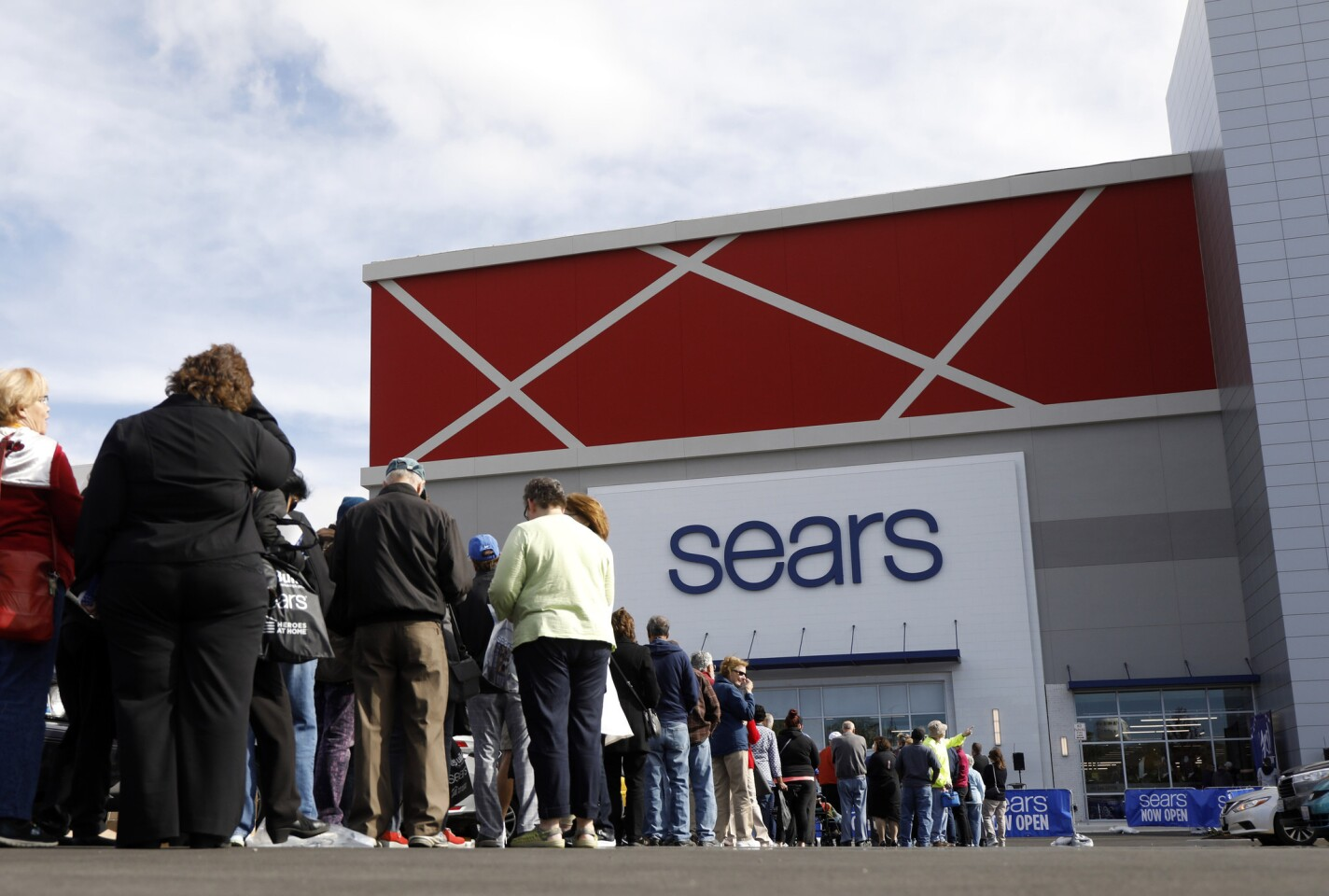 Customers line up for the re-opening event at a renovated Sears store, Oct. 4, 2018 at Oakbrook Center.