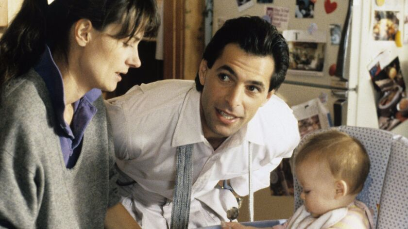 """""""thirtysomething"""" stars Ken Olin (as Michael Steadman) and Mel Harris (as Hope Steadman), with baby Lacy Craven (as Brittany)."""