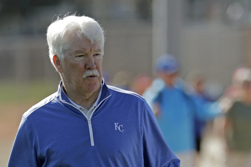 Kansas City Royals owner John Sherman watches a workout during spring training.