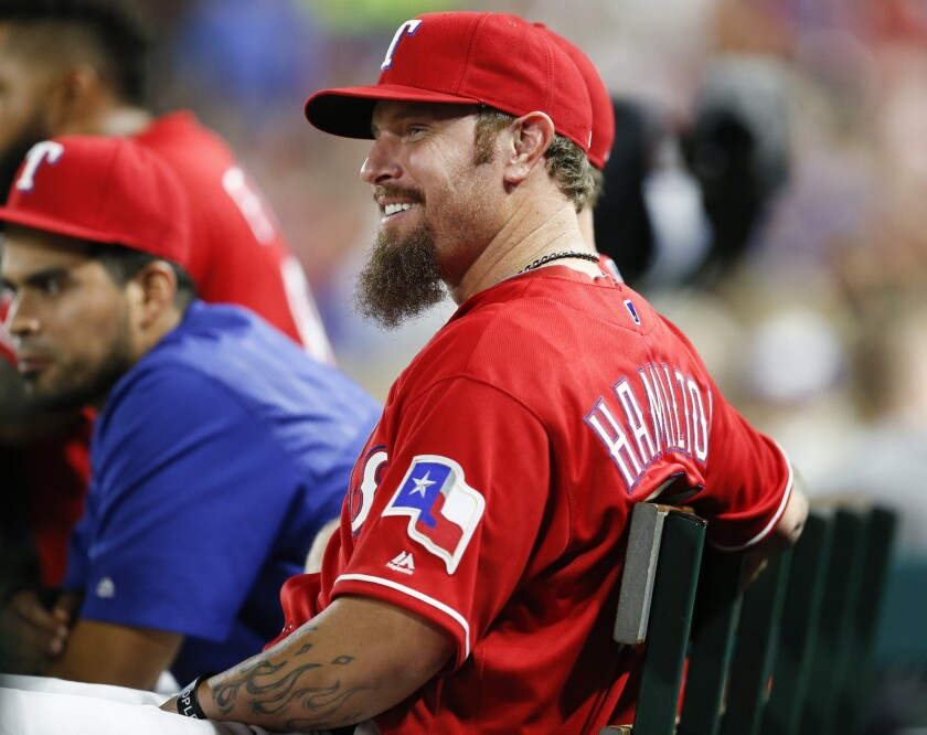 Rangers outfielder Josh Hamilton watches from the bench during the fifth inning of a game against the Orioles on Apr. 16.