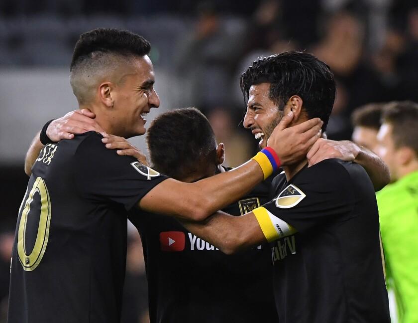 Carlos Vela celebrates with LAFC teammate Eduard Atuesta after scoring against FC Cincinnati in April.