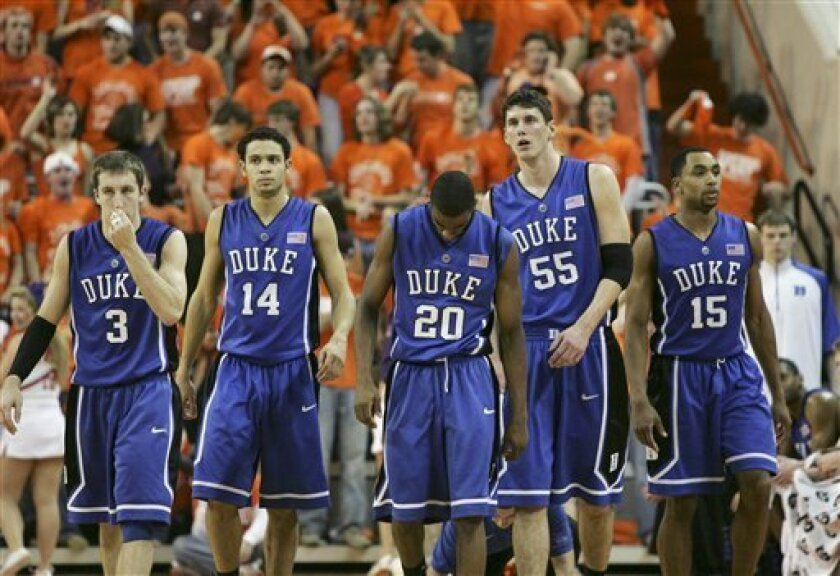 Duke's Greg Paulus (3), David McClure (14), Elliot Williams (20), Brian Zoubek (55) and Gerald Henderson (15) walk out onto the court for the last few minutes of the NCAA college basketball game which Clemson won 74-47 Wednesday, Feb. 4, 2009, at Littlejohn Coliseum in Clemson, S.C. (AP Photo/Mary Ann Chastain)
