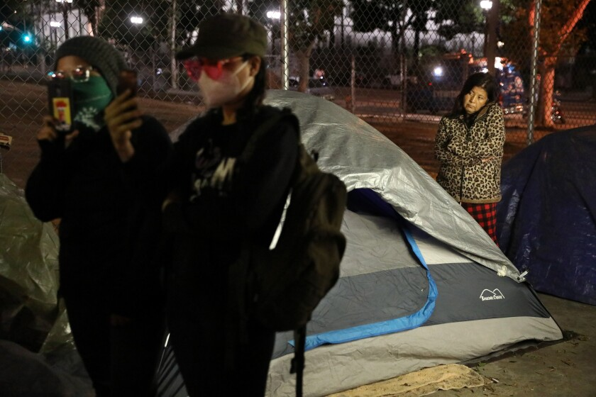 Eleanor Altamira waits to get back to her tent
