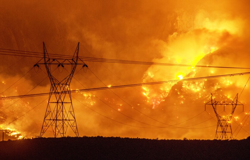 a wildfire approaching power lines
