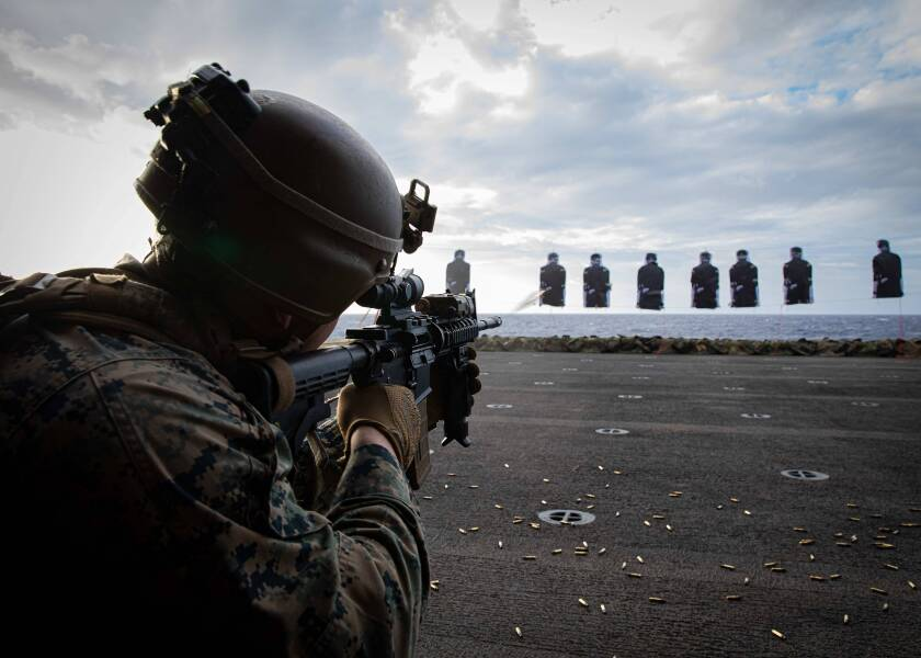 Lance Cpl. Josiah Grimes, assigned to the 26th Marine Expeditionary Unit, participates in a gun shoot aboard the amphibious assault ship USS Bataan (LHD 5), Dec. 26, 2019. Bataan, operating in the Atlantic Ocean, was ordered to the Mideast region Friday in response to escalating tensions with Iran.