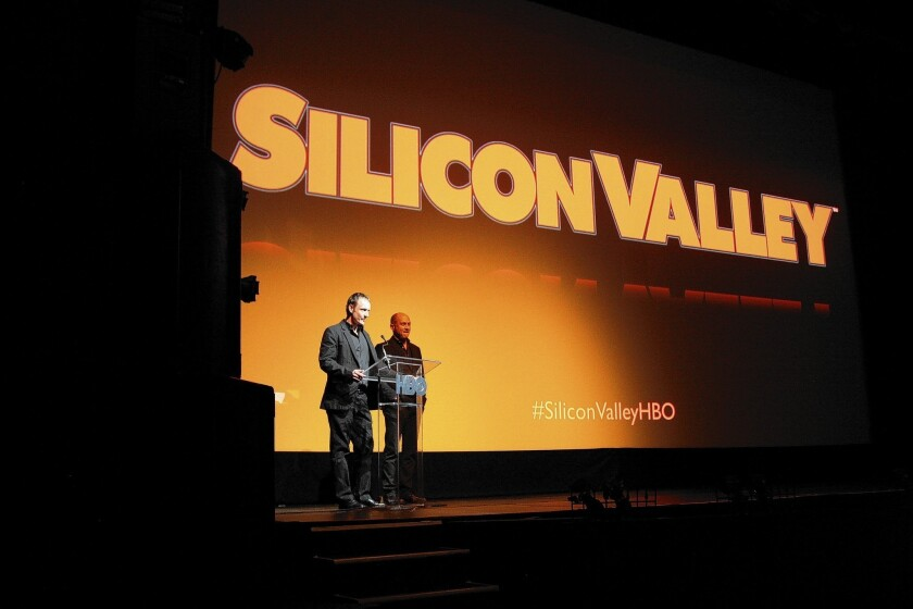 """Alec Berg, left, and Mike Judge introduce HBO's new """"Silicon Valley"""" series at a screening at the historic Fox Theatre in Redwood City, Calif. The producers say they went to great lengths to get the details just right."""