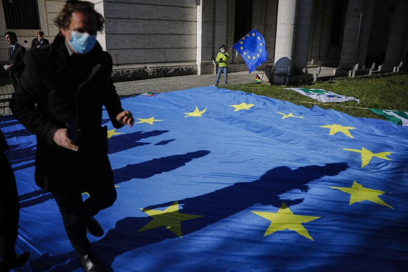 A European flag decorates an event in Berlin to collect signatures for more support for Italy during the COVID-19 pandemic.