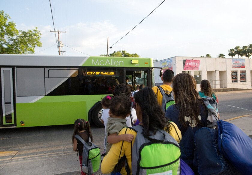 Immigrant families, many of them mothers with children, board a bus in April headed to McAllen, Texas. The immigrants had crossed the Rio Grande and were later released from Border Patrol custody with notices to appear in immigration court.