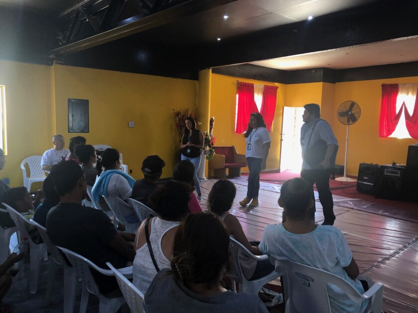 Representatives from the United Nations High Commissioner for Refugees met Tuesday with migrants at the Agape Mision Mundial shelter in Tijuana to share information about applying for asylum in Mexico, amid policy changes in the United States.