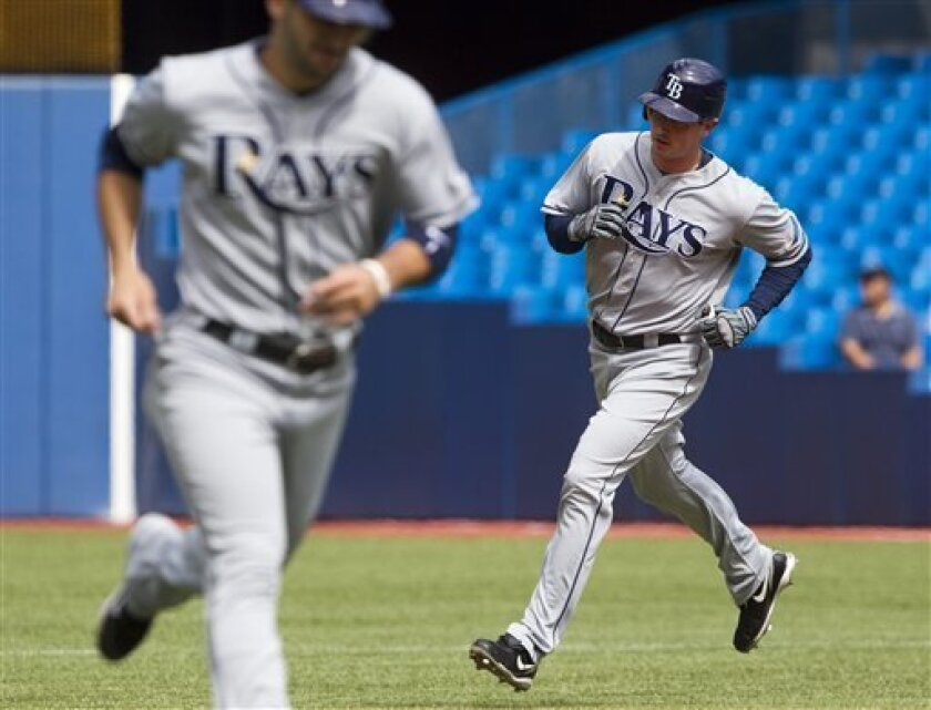 Tampa Bay Rays' Brad Hawpe follows teammate Sean Rodriguez around the bases on his grand slam off Toronto Blue Jays starting pitcher Ricky Romero during fourth inning AL action in Toronto on Saturday Sept. 11, 2010. (AP Photo/The Canadian Press, Frank Gunn)