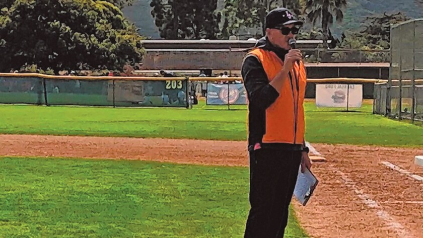 La Jolla Youth Baseball president Jim Sampson offers a welcome to players and families on Opening Day.