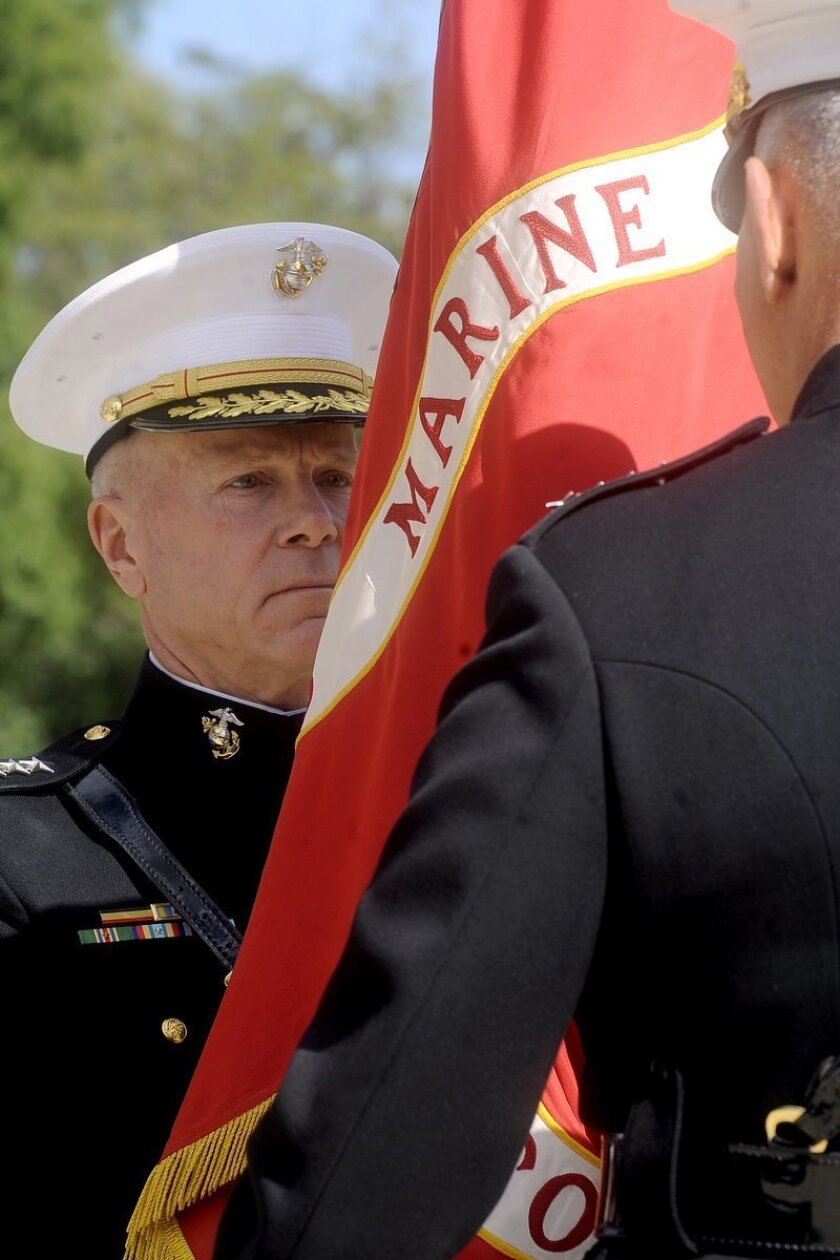 The 35th Commandant of the Marine Corps Gen. James F. Amos accepts command from Gen. James T. Conway during a Passage of Command ceremony presided over by Secretary of Defense Robert M. Gates at the Marine Barracks, Washington, D.C., on Oct. 22, 2010.