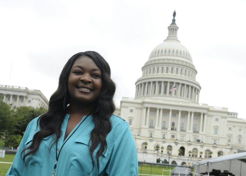"""FILE - This July 3, 2013 file photo shows American Idol 2013 winner Candice Glover on Capitol Hill in Washington. Glover from """"American Idol"""" will help reopen the Washington Monument, which has been closed since a 2011 earthquake. Organizers say Glover will join with the Old Guard Fife and Drum Corps, the U.S. Navy Band and the boy and girl choristers of the Washington National Cathedral Choir for the May 12 re-opening ceremony. The """"Today"""" show's Al Roker will host the event. (AP Photo/Susan Walsh, File)"""