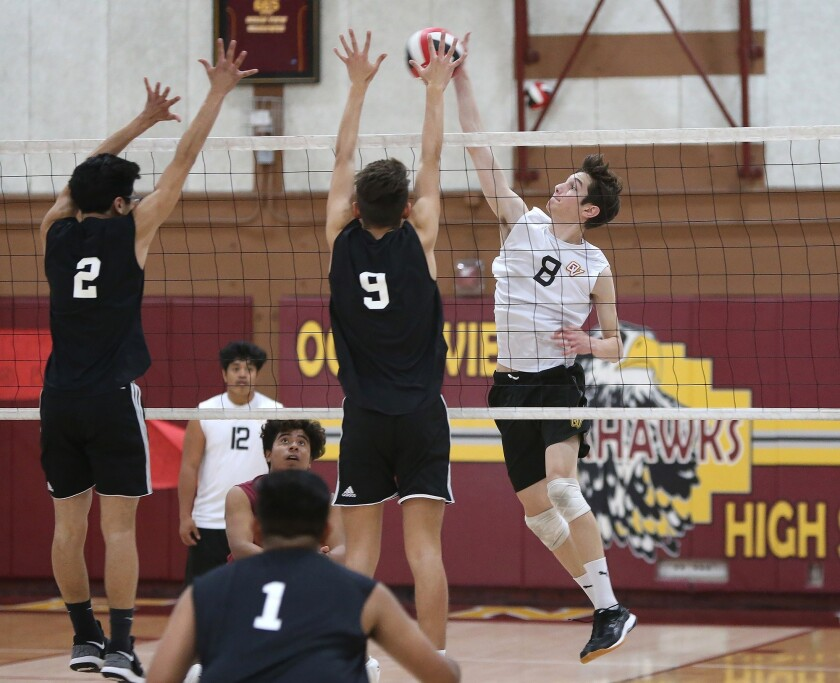 Ocean View's Jackson Petrovich tries to put a ball past Cesar Mascareno (2) and Nathan Escobedo (15)
