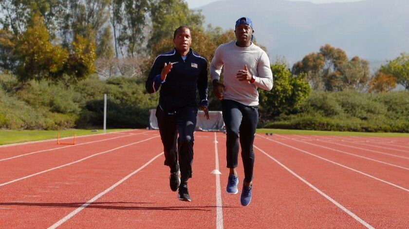 Guide runner Jerome Avery (right) and blind Paralympian David Brown (left) work out at the outdoor track at Chula Vista Elite Athlete Training Center.