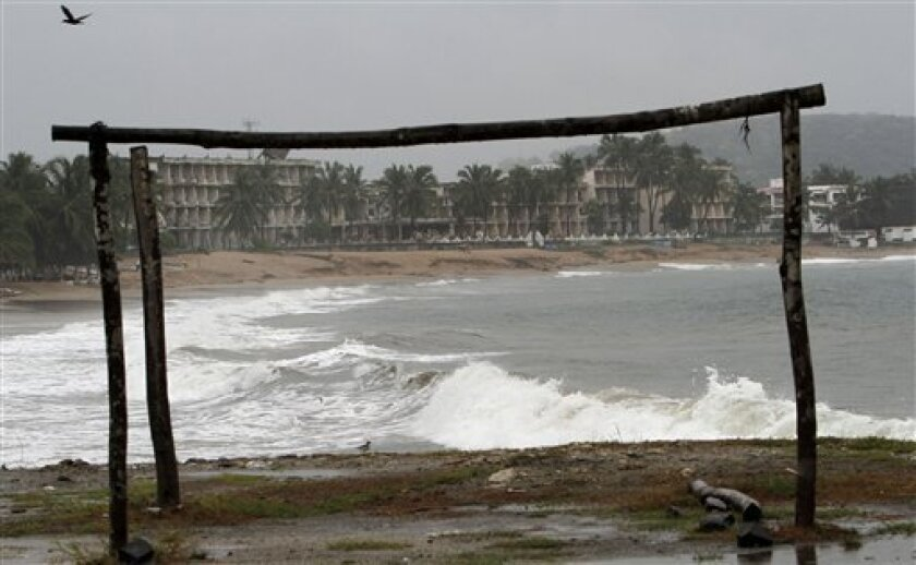 A wooden frame used for a palapa-roofed beach restaurant sits abandoned before the anticipated arrival of Hurricane Jova in Melaque, Mexico, Tuesday Oct. 11, 2011. Jova weakened a little as it neared land, but it still had maximum sustained winds of 100 mph, the U.S. National Hurricane Center reported, forecast to make landfall between Barra de Navidad, near Melaque, and Puerto Vallarta late Tuesday. Some residents began taking refuge at storm shelters in towns like Jaluco, just inland from the beach community of Barra de Navidad. (AP Photo/Marco Ugarte)