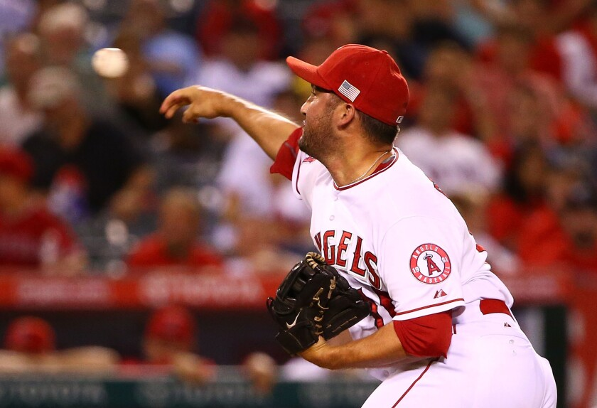 Closer Huston Street pitches during the ninth inning of a game against the Houston Astros in Anaheim on Sept. 11.