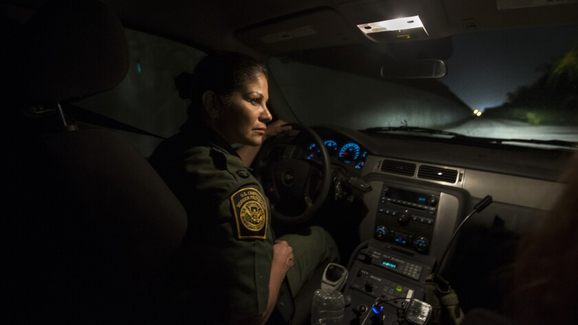 U.S. Border Patrol Agent Marlene Castro keeps an eye out for drug smugglers and migrants illegally c