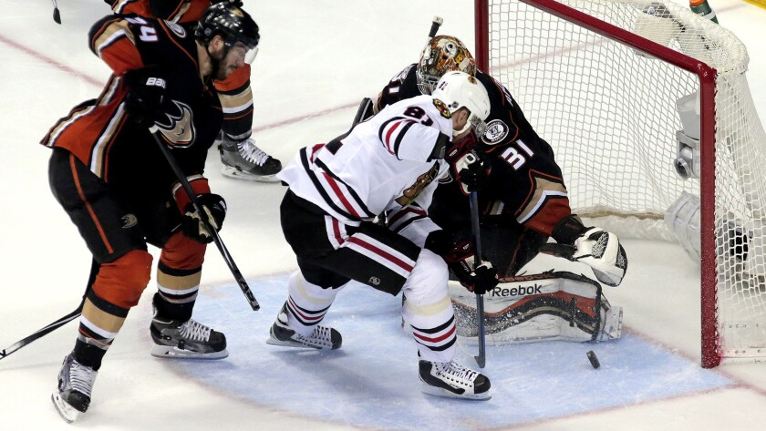 Blackhawks right wing Marian Hossa (81) knocks in a goal off his skate on a rebound against Ducks defenseman Simon Despres and goalie Frederik Andersen in the second period of Game 7.