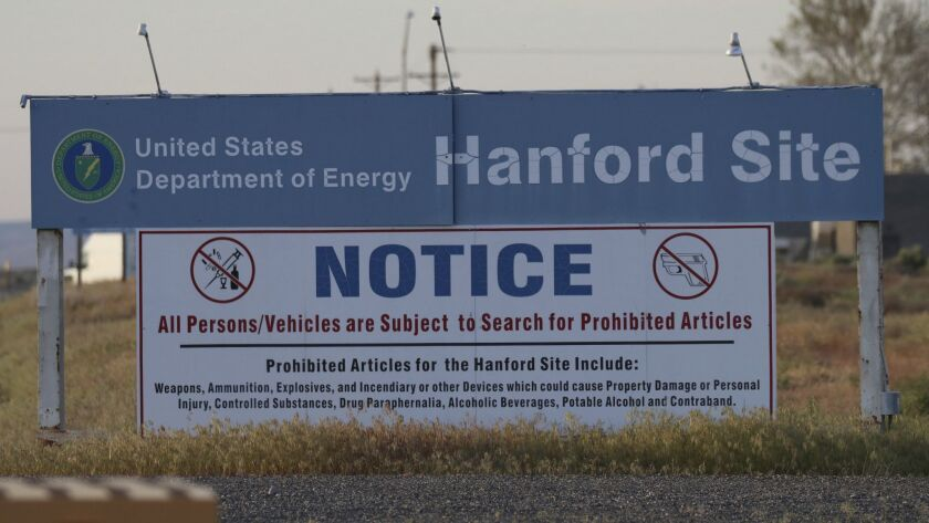 FILE - In this May 9, 2017, file photo, signs are posted by the Hanford Nuclear Reservation in Bento