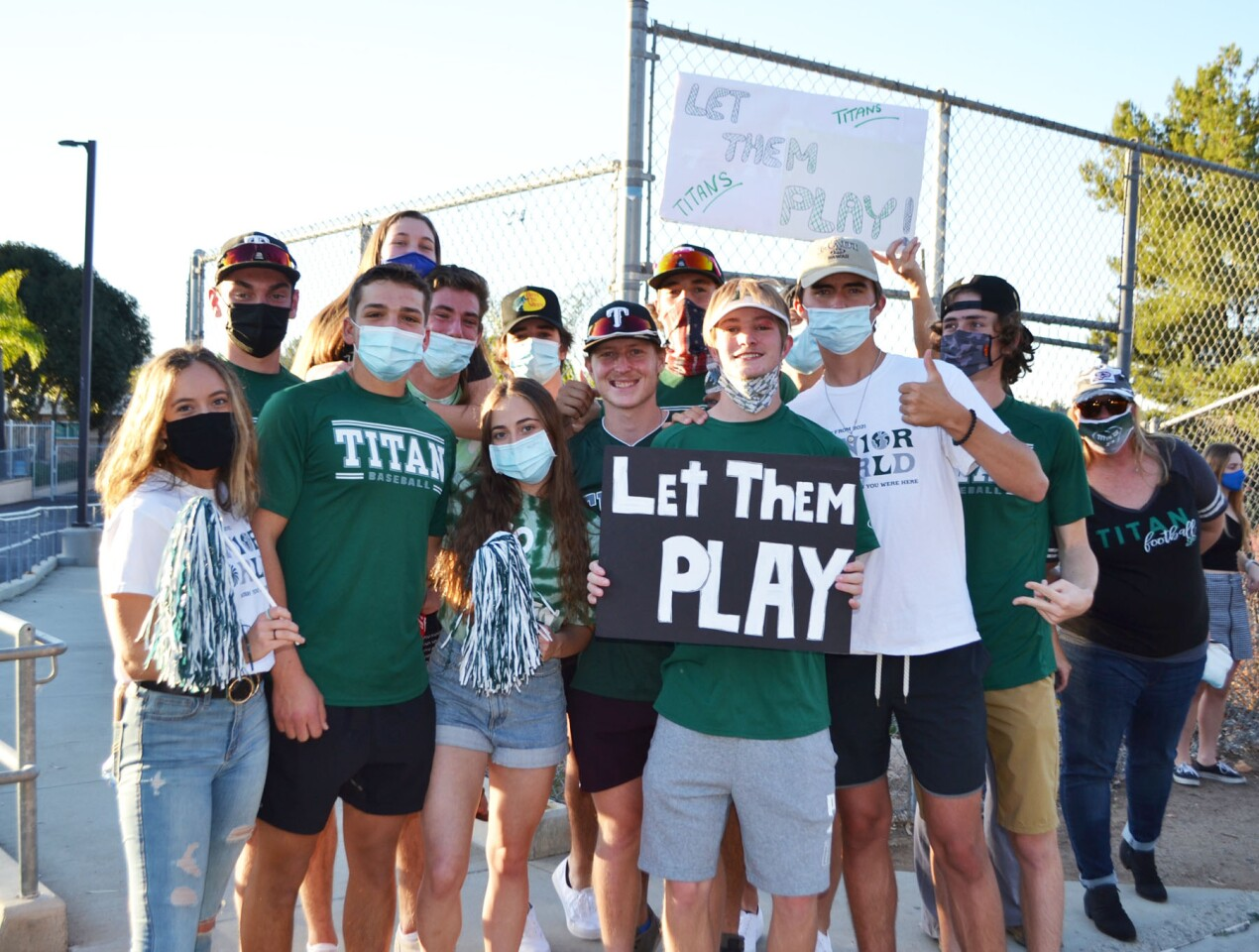 Members of Poway High's baseball teams and friends joined the rally.