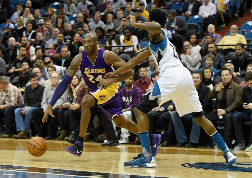 Lakers forward Kobe Bryant drives toward the basket against Timberwolves forward Andrew Wiggins during the first quarter of Wednesday's game in Minneapolis.