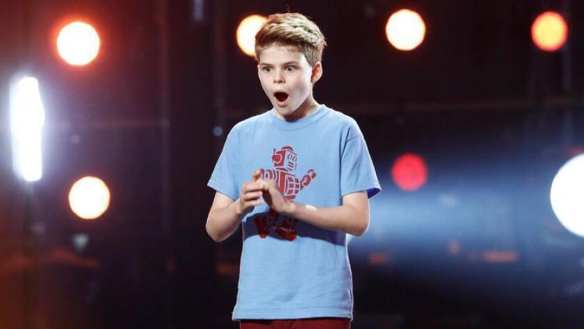 "Merrick Hanna reacts in shock when he learns he's made it through to the semifinals round on ""Americ"