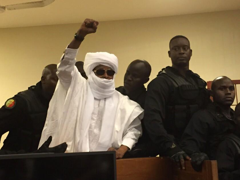 Chad's former dictator Hissene Habre raises his hand during court proceedings in Dakar, Senegal, on Monday.
