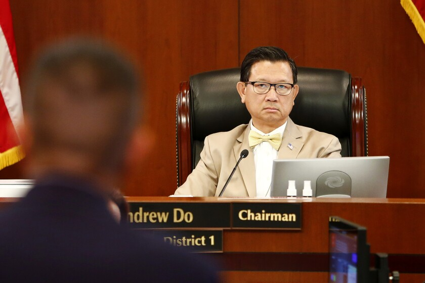 County Supervisor Andrew Do listens at an Orange County Board of Supervisors meeting