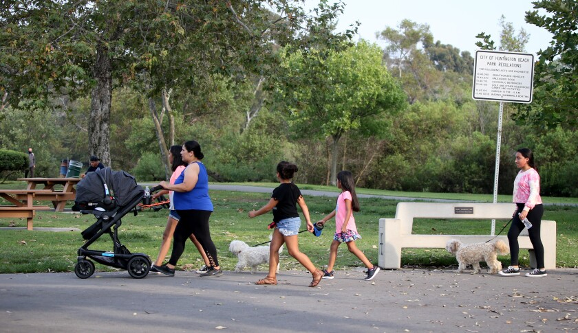 A woman and her children get some exercise at Central Park in Huntington Beach.