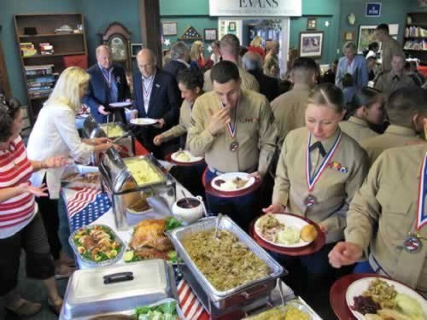 The Evans School host active and veteran marines for a Thanksgiving lunch on Nov. 19. Courtesy