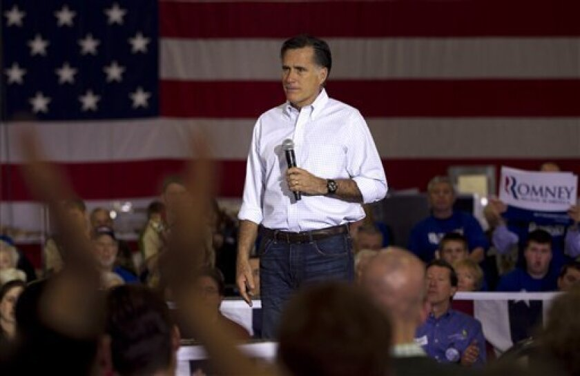 Republican presidential candidate, former Massachusetts Gov. Mitt Romney, reacts to audience applause as he spoke at campaign stop in Muskego, Wis., Saturday, March 31, 2012. (AP Photo/Steven Senne)
