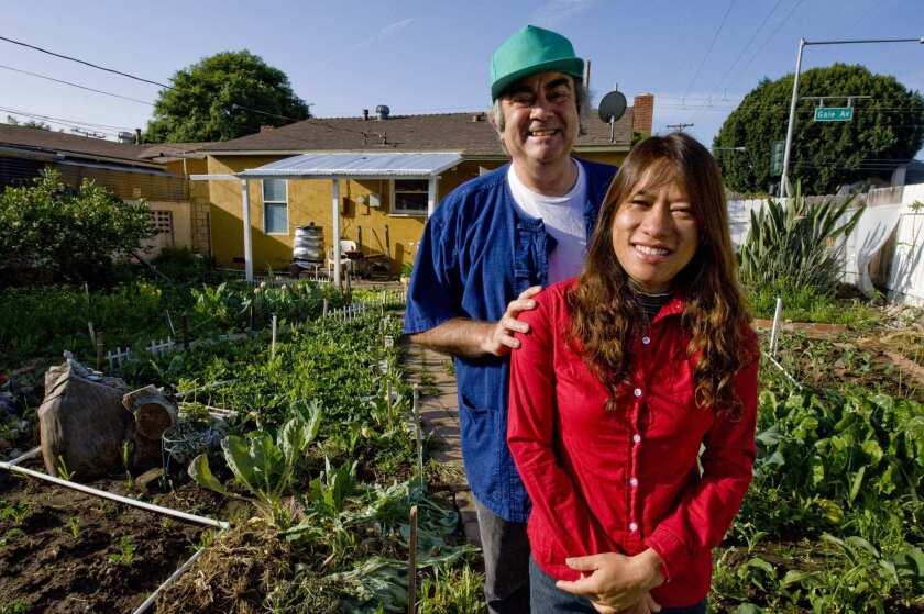 Brett and Tanya Wyatt in their garden at B&T Farm in Hacienda Heights.