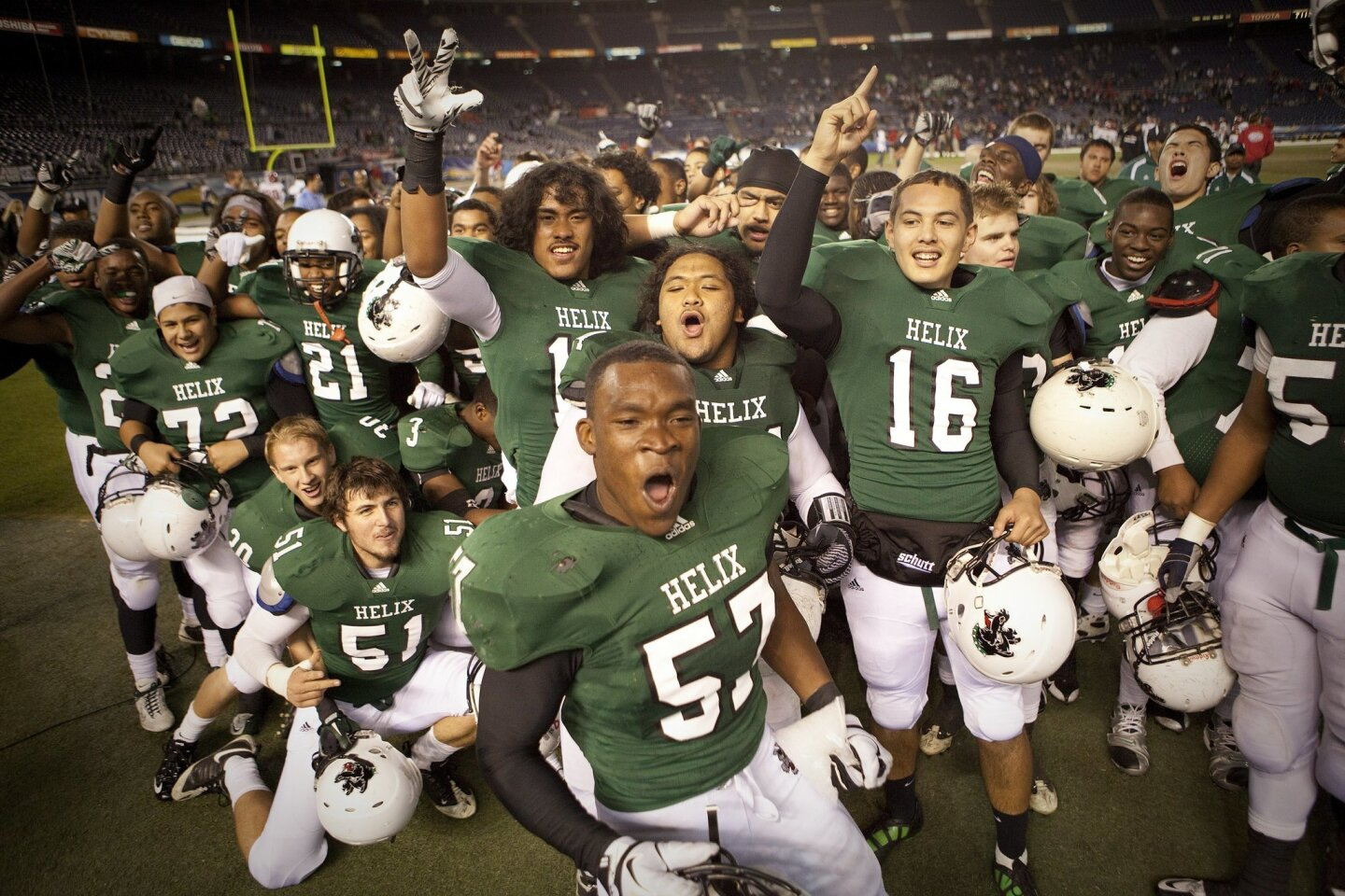 Helix #57 Ernest Shipley lead his team after Helix 44-6 rout of Oceanside for the San Diego Section Division 2 title.