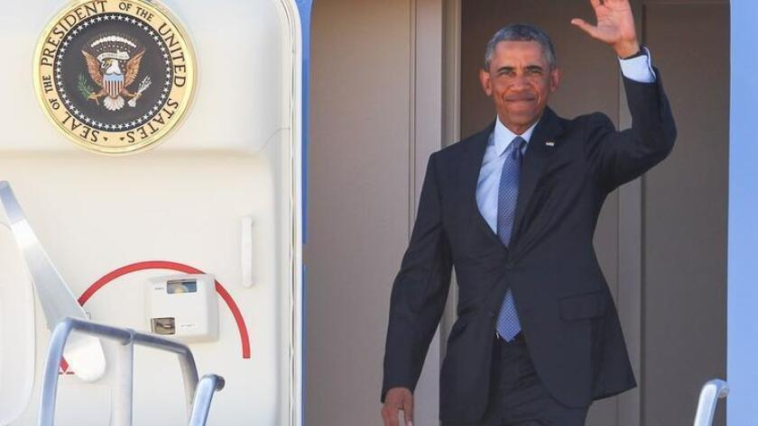 President Barack Obama waves while exiting Air Force One upon his arrival at McCarran International Airport, Monday, Aug. 24, 2015, in Las Vegas. (AP Photo/Chase Stevens) (/ The Associated Press)
