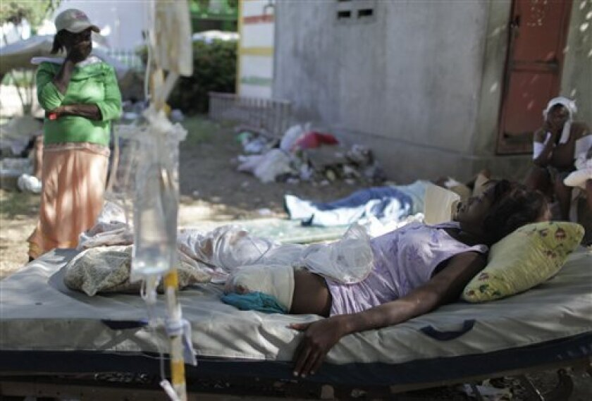 A woman who lost her leg due to injures sustained during the earthquake lies at the backyard of the General Hospital in Port-au-Prince, Saturday, Jan. 16, 2010. A powerful earthquake struck Haiti on Tuesday.( AP Photo/Ariana Cubillos)
