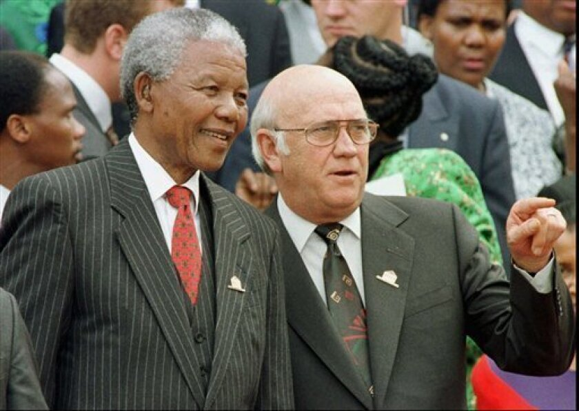FILE - In this Wednesday May 8, 1996 file photo, South African President Nelson Mandela, left, and Deputy President F.W. de Klerk chat outside Parliament after the approval of South Africa's new constitution. de Klerk, the last leader of the apartheid era and a co-recipient of the 1993 Nobel Peace Prize with Nelson Mandela, has suffered dizziness and will be fitted with a pacemaker, Tuesday June 2, 2013, to help his heart function. (AP Photo/POOL)