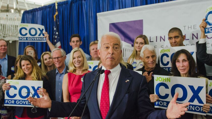 John Cox, a Republican candidate for governor, speaks to supporters during a primary night party in San Diego, Calif., last year. The Cox campaign committee has been ordered to pay almost $100,000 to an advertising agency.