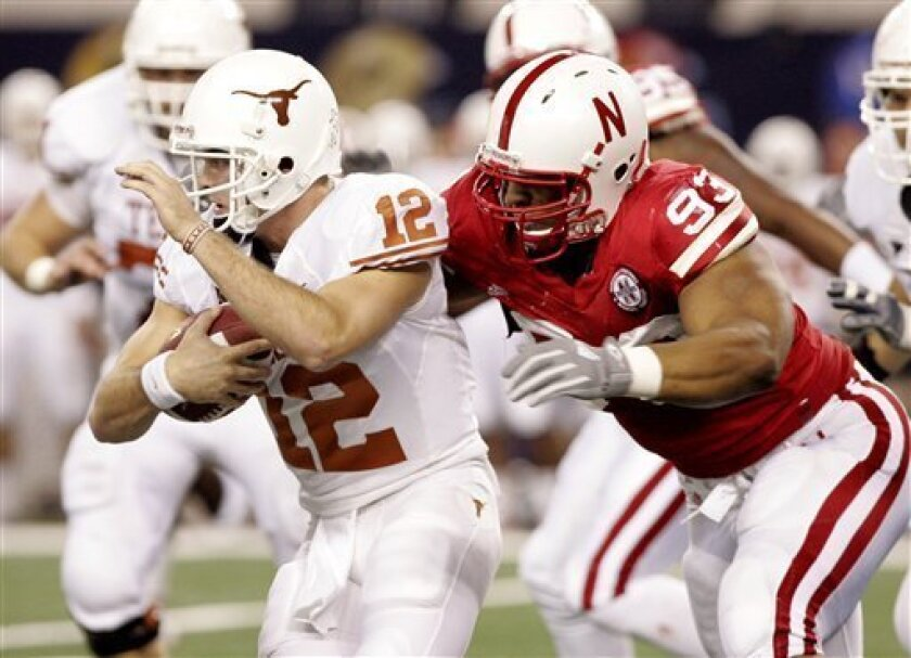 Texas quarterback Colt McCoy (12) is sacked by Nebraska defensive tackle Ndamukong Suh (93) in the first half of an NCAA college football Big 12 Conference championship game, Saturday, Dec. 5, 2009, in Arlington, Texas. (AP Photo/Amy Gutierrez)